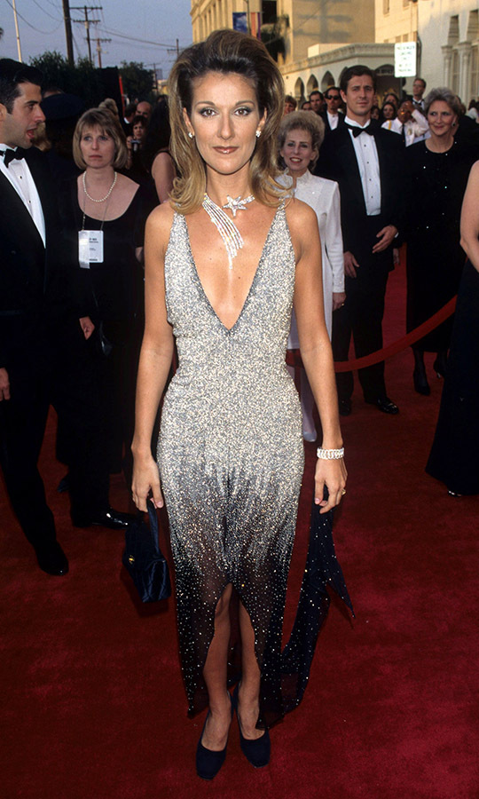 <h2>1997</h2><p>What a star! Canadian icon <a href=/tags/0/celine-dion><strong>Céline Dion</strong></a> shone at the 69th Annual Academy Awards with her sparkly ombré dress and shooting star necklace.<p>Photo: &copy; Ke.Mazur/WireImage