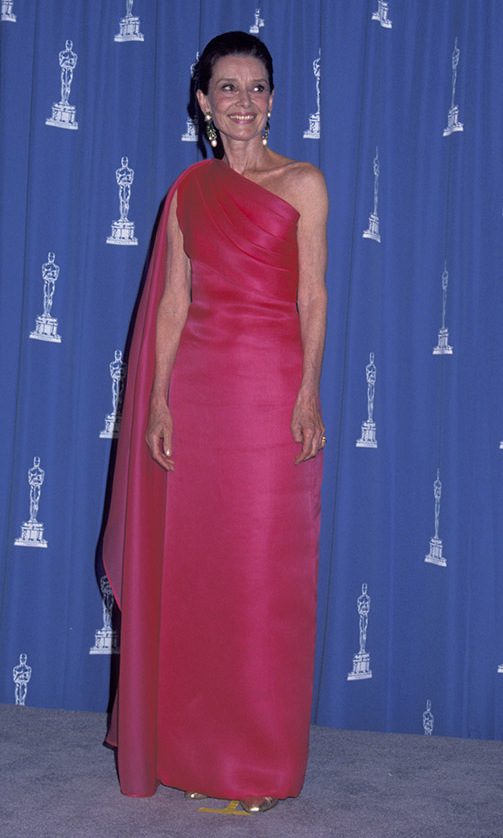 <h2>1992</h2><p>At the 64th Annual Academy Awards, <strong><A HREF=/tags/0/audrey-hepburn>Audrey Hepburn</a></strong> solidified her status as a style icon in a hot pink gown with draped shoulder. <p>Photo: &copy; Ron Galella/Ron Galella Collection via Getty Images