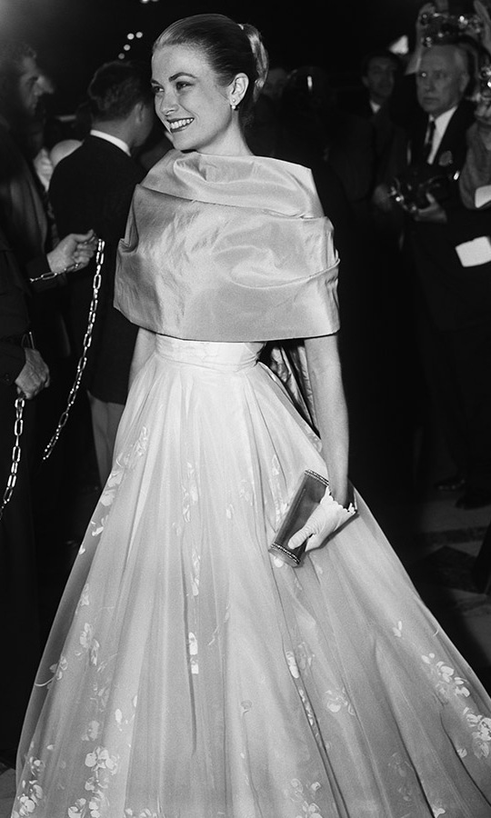 <h2>1956</h2><p><strong><a href=/tags/0/princess-grace>Grace Kelly</a></strong> defined timeless elegance at the 28th Annual Academy Awards in a full skirt and short evening gloves. It was her last Oscars appearance before leaving Hollywood to marry <strong><a href=/tags/0/prince-rainier>Prince Rainier</a></strong> of Monaco. <p>Photo: &copy; Bettmann