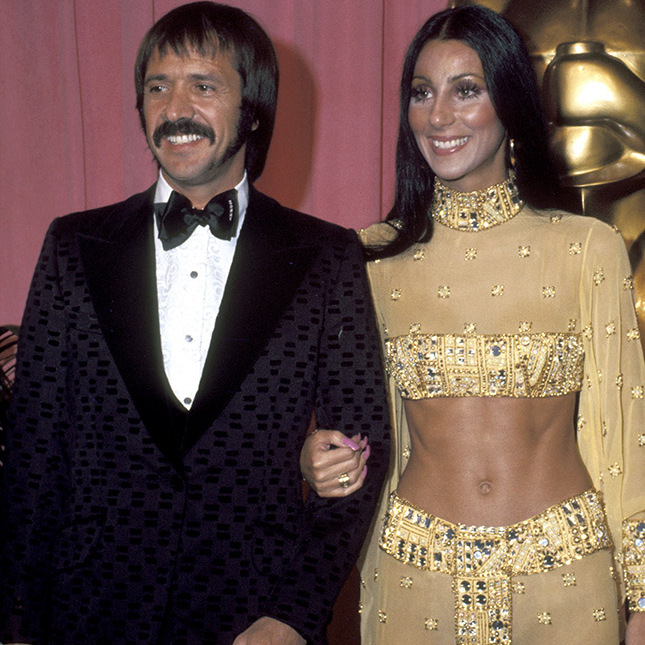 <h2>1973</h2><p>No one does the red carpet like <a href=/tags/0/cher><strong>Cher</strong></a>! The singer-actress wore a decorative yellow crop top and skirt to the 45th Annual Academy Awards. She attended with <strong>Sonny Bono</strong>. <p>Photo: &copy; Jim Smeal/Ron Galella Collection via Getty Images
