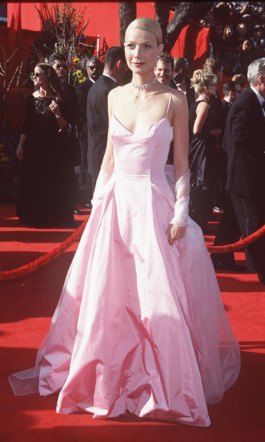 <h2>1999</h2><p><a href=/tags/0/gwyneth-paltrow><strong>Gwyneth Paltrow</strong></a> had an iconic moment in a romantic cotton candy pink gown by <a href=/tags/0/ralph-lauren><strong>Ralph Lauren</strong></a> at the 71st Annual Academy Awards. She took home the Best Actress award for <em>Shakespeare in Love</em>.<p>Photo: &copy; Jeffrey Mayer/WireImage