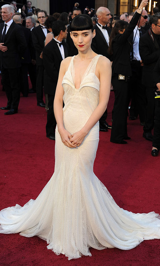 <h2>2012</h2><p>Fresh from <em>The Girl With the Dragon Tattoo</em>, <a href=/tags/0/rooney-mara><strong>Rooney Mara</strong></a> captivated at the 84th Annual Academy Awards in a white <a href=/tags/0/givenchy><strong>Givenchy Couture</strong></a> dress with unique detailing and a striking beauty look. <p>Photo: &copy; Michael Buckner/Getty Images