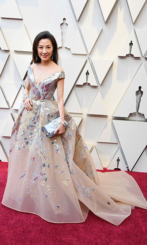<h2>2019</h2></p><em>Crazy Rich Asians</em> actress <strong>Michelle Yeoh</strong> turned heads in a full embroidered dress by <a href=/tags/0/elie-saab><strong>Elie Saab</strong></a> at the 91st Annual Academy Awards. <p> Photo: &copy; Steve Granitz/WireImage