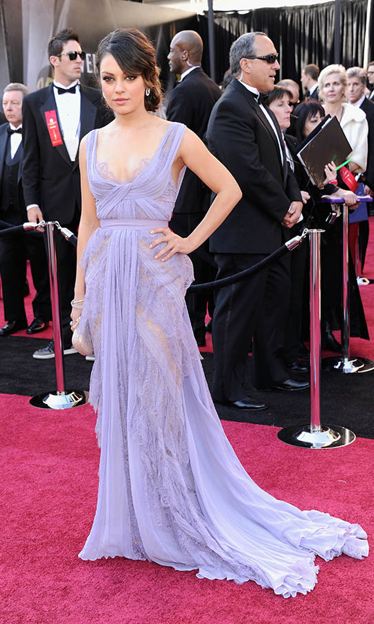 <h2>2011</h2><p>Belle of the ball! Best Supporting Actress nominee <a href=/tags/0/mila-kunis><strong>Mila Kunis</strong></a> charmed at the 83rd Annual Academy Awards in a lacy lavender dress by <a href=/tags/0/elie-saab><strong>Elie Saab Haute Couture</a></strong>. <p>Photo: &copy; Kevin Mazur/WireImage