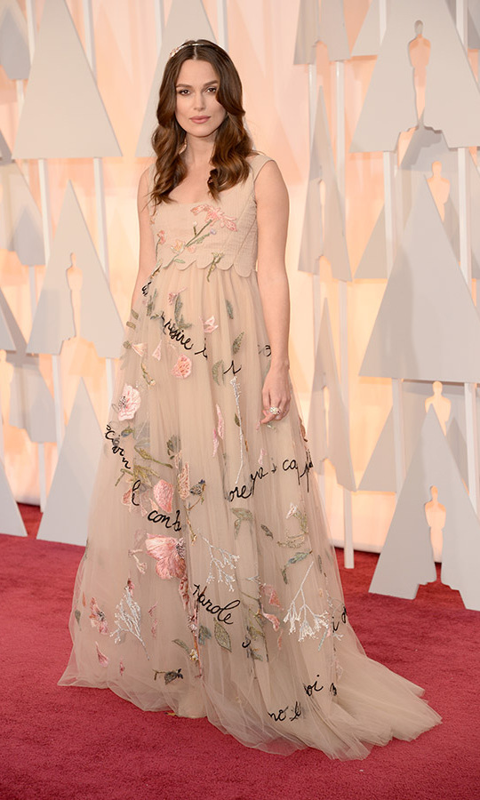 <h2>2015</h2><p>An expectant Keira Knightley made a joyful statement in a full tulle <a href=/tags/0/valentino><strong>Valentino Couture</strong></a> gown decorated with floral embroidery and phrases written in cursive.<p>Photo: &copy; Kevin Mazur/WireImage