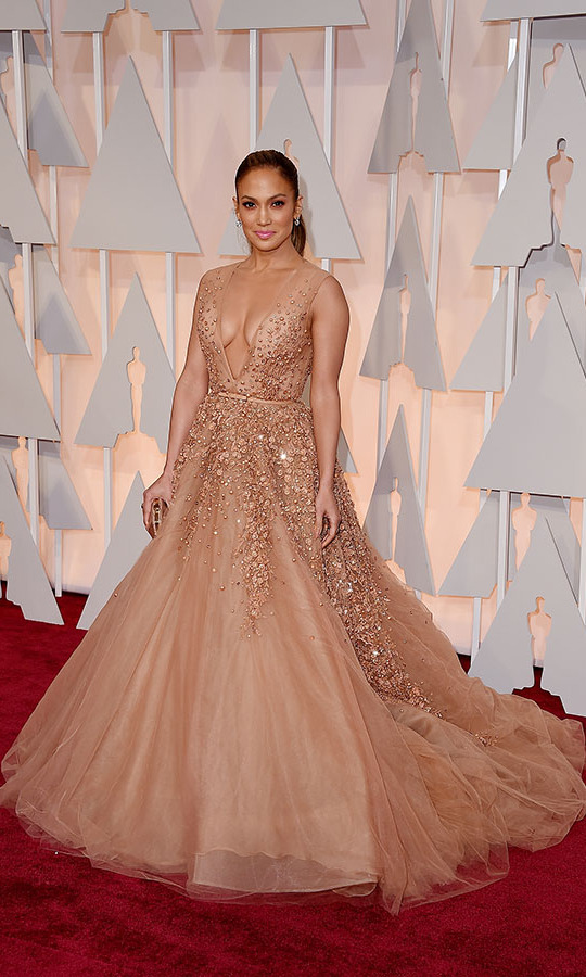<h2>2015</h2><p><a href=/tags/0/jennifer-lopez><strong> Jennifer Lopez</strong></a> had a romantic turn at the 87th Annual Academy Awards in a neutral <a href=/tags/0/elie-saab><strong>Elie Saab</strong></a> ballgown with cascade of sparkle.<p>Photo: &copy; Steve Granitz/WireImage