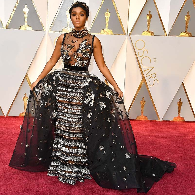 <h2>2017</h2><p>Singer-actress <a href=/tags/0/janelle-monae><strong>Janelle Monáe</strong></a> arrived in style at the 89th Annual Academy Awards in a dramatic <a href=/tags/0/elie-saab><strong>Elie Saab Haute Couture</strong></a> gown that looked straight out a fairy tale. <p>Photo: &copy; Steve Granitz/WireImage