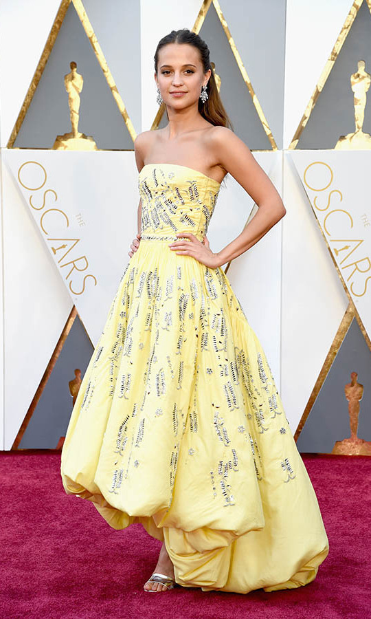<h2>2016</h2><p> Best Supporting Actress winner <a href=/tags/0/alicia-vikander><strong>Alicia Vikander</strong></a> made everyone smile with her custom yellow <a href=/tags/0/louis-vuitton><strong>Louis Vuitton</strong></a> dress with balloon hem and swipes of embellishment. <p>Photo: &copy; Jeff Kravitz/FilmMagic