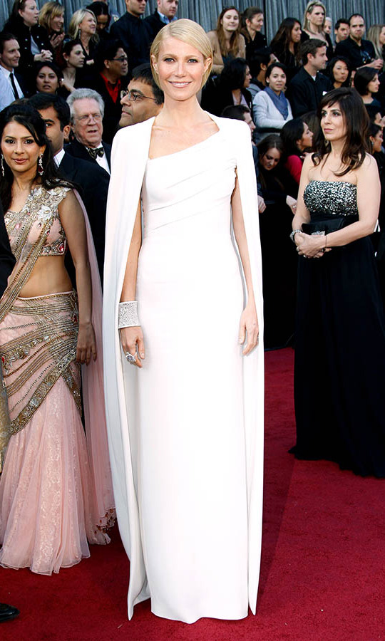 <h2>2012</h2><p><a href=/tags/0/gwyneth-paltrow><strong>Gwyneth Paltrow</strong></a> oozed elegance in a pristine white column dress and cape by <a href=/tags/0/tom-ford><strong>Tom Ford</strong></a>.<p>Photo: &copy; Dan MacMedan/WireImage