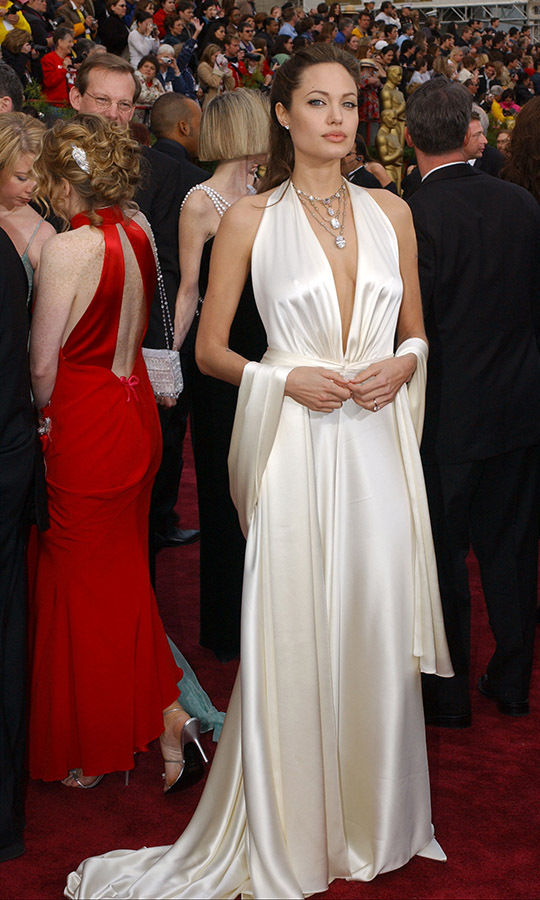<h2>2004</h2></p><a href=/tags/0/angelina-jolie><strong>Angelina Jolie</strong></a> looked effortlessly chic in a silky <strong>Marc Bouwer</strong> gown and matching wrap at the 76th Annual Academy Awards. <p>Photo: &copy; Bob Riha Jr/WireImage