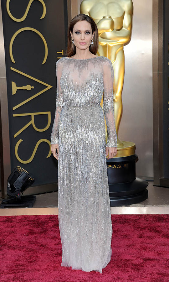 <h2>2014</h2><p>All that glitters! Angelina Jolie stepped out to the 2014 Oscars in a shimmering <a href=/tags/0/elie-saab><strong>Elie Saab Couture</strong></a> dress with illusion details. <p>Photo: &copy; Kevin Mazur/WireImage