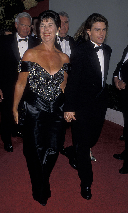 <strong><a href=/tags/0/tom-cruise>Tom Cruise</a></strong> held his mother <strong>Mary Lee South</strong>'s hand when they arrived at the 1990 Oscars. He was up for Best Actor for <i>Born on the Fourth of July</i>.