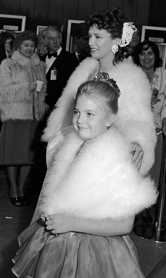 So cute! <strong><a href=/tags/0/drew-barrymore>Drew Barrymore</a></strong>'s mother, <Strong>Jaid</strong>, was no stranger to Oscars night, coming from an Old Hollywood family! Drew was just eight years old when she hit this red carpet after playing Gertie in <i>E.T. the Extra-Terrestrial</i> the year before.