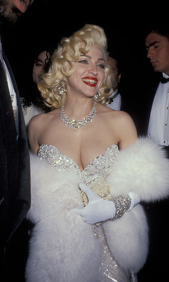 <a href=/tags/0/madonna><strong>Madonna</strong></a> was dripping in diamonds at the 1991 Oscars. Literally! She wore over $20 million worth of <a href=/tags/0/harry-winston><strong>Harry Winston</strong></a> diamonds. She upped the glamour factor further with a furry stole, beaded dress and <strong>Marilyn Monroe</strong>-inspired beauty look. <p>Photo: &copy; Ron Galella/Ron Galella Collection via Getty Images