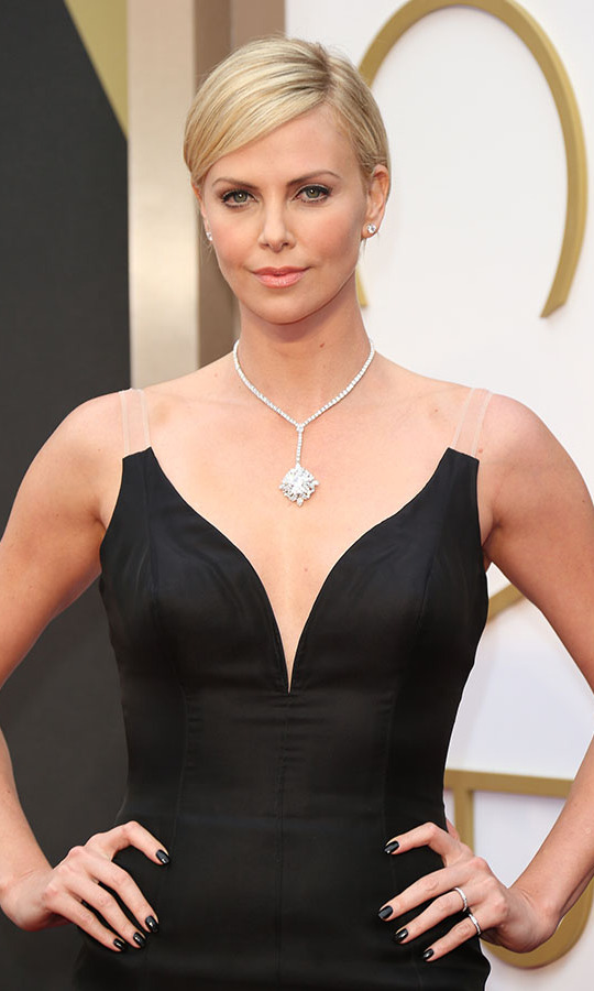 The illusion neckline on <a href=/tags/0/charlize-theron><strong>Charlize Theron</strong></a>'s black gown was something, but it was her necklace that was the focal point. The <a href=/tags/0/harry-winston><strong>Harry Winston</strong></a> 31-karat diamond pendant was not to be missed. <p>Photo: &copy; Dan MacMedan/WireImage