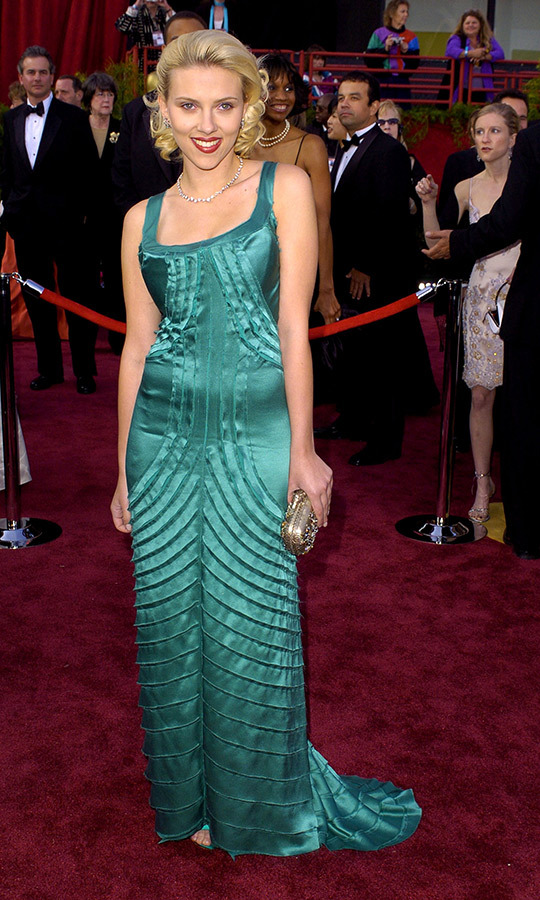 <strong><a href=/tags/0/scarlett-johansson>Scarlett Johansson</a></strong>, who is a double nominee this year, wore this striking teal gown to her first Oscars in 2004.