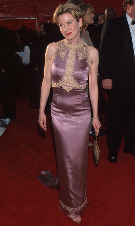 <strong><a href=/tags/0/renee-zellweger>Renee Zellweger</strong></a> chose a gorgeous mauve gown with gold embroidering for her first Oscars in 1999!