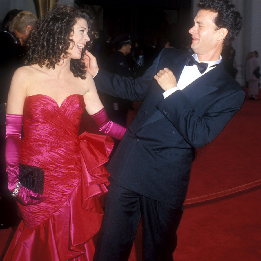 So sweet! <strong><a href=/tags/0/tom-hanks>Tom Hanks</strong></a> hammed it up with <strong><a href=/tags/0/rita-wilson>Rita Wilson</a></strong>, his wife, at the Oscars in 1989. He was nominated for Best Actor for <i>Big</i> that year.