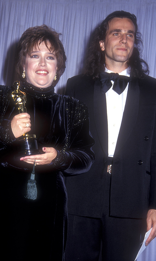 <strong><a href=/tags/0/kathy-bates>Kathy Bates</a></strong> glimmered as she stood next to <strong>Daniel Day-Lewis</strong> as she showed off her Best Actress Oscar for <i>Misery</i> in 1991. 