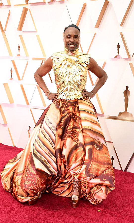 <a href=/tags/0/billy-porter><strong>Billy Porter</strong></a> absolutely slayed in a <strong>Giles Deacon Couture</strong> outfit featuring a fierce printed skirt and feathered armour-like bodice. He paired it with Jimmy Choo shoes, a custom <strong>Judith Leiber Couture</strong> handbag, <strong>Dita</strong> eyewear and Atelier Swarovski jewellery.<p>Photo: &copy; Steve Granitz/WireImage