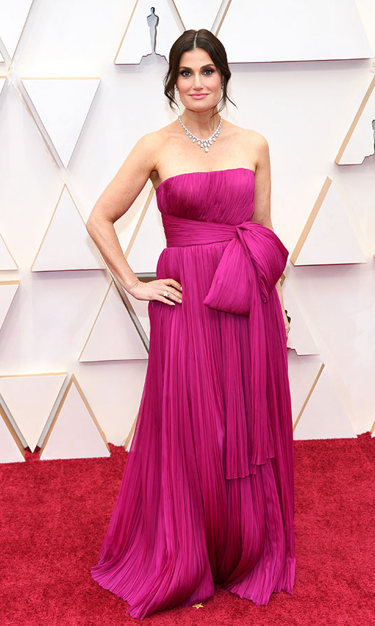 <em>Frozen</em> singer <a href=/tags/0/idina-menzel><strong>Idina Menzel</strong></a> brightened up the carpet in a fuchsia gown that was tied in a bow. <p>Photo: &copy; Kevin Mazur/Getty Images