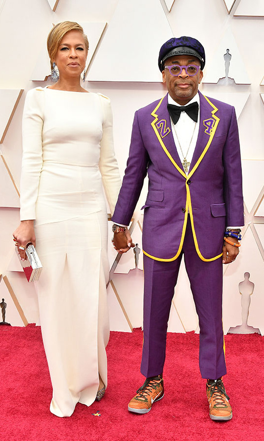 Director <a href=/tags/0/spike-lee><strong>Spike Lee</strong></a>, with wife <strong>Tonya Lewis Lee</strong>, paid tribute to the late <a href=/tags/0/kobe-bryant><strong>Kobe Bryant</strong></a> with his custom purple and yellow <a href=/tags/0/gucci><strong>Gucci</strong></a> suit. <p>Photo: &copy; Amy Sussman/Getty Images