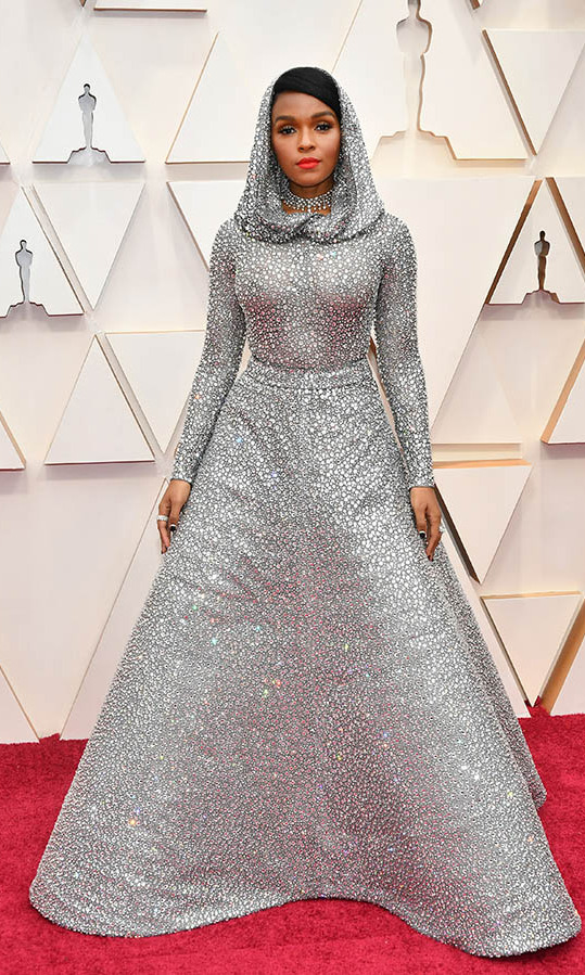 Singer-actress <a href=/tags/0/janelle-monae><strong>Janelle Monáe</strong></a> had a fairytale moment in a shimmering <a href=/tags/0/ralph-lauren>Ralph Lauren</a></strong> gown complete with a hood! She paired it with Forevermark jewellery. <p>Photo: &copy; Amy Sussman/Getty Images