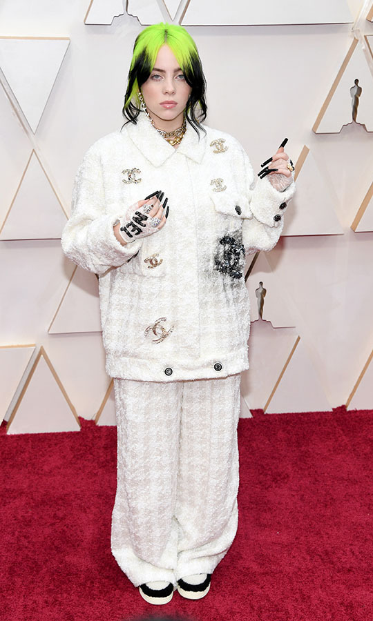 GRAMMY winner <a href=/tags/0/billie-eilish><strong>Billie Eilish</strong></a> showcased her cool signature style in an oversized <a href=/tags/0/chanel><strong>Chanel</strong></a> suit. <p>Photo: &copy; Kevin Mazur/Getty Images
