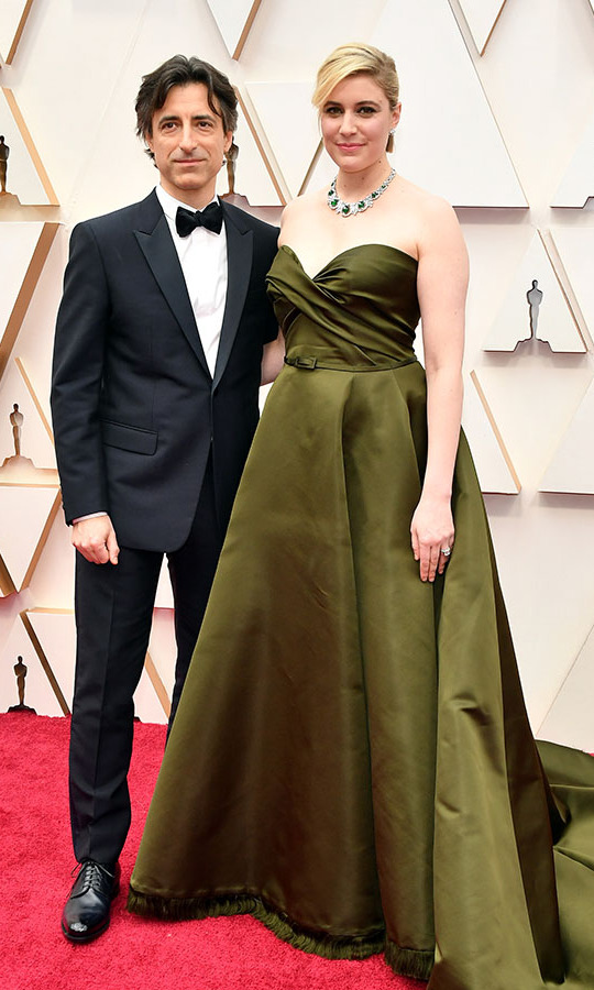 Filmmakers and Hollywood power couple <a href=/tags/0/noah-baumbach><strong>Noah Baumbach</strong></a> and <a href=/tags/0/greta-gerwig><strong>Greta Gerwig</strong></a> struck a pose at the 92nd Annual Academy Awards. The <em>Little Women</em> director wowed in a custom <a href=/tags/0/dior><strong>Dior</strong></a> gown and ornate choker by <strong><a href=/tags/0/bulgari>Bulgari</a></strong>. Noah's suit is by <strong>Dior Couture Homme</strong>. <p>Photo: &copy; Amy Sussman/Getty Images