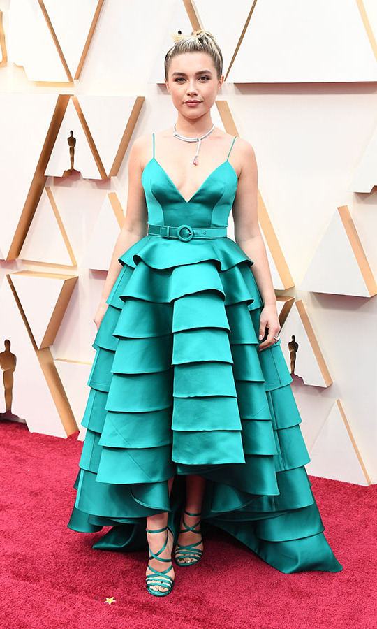 Best Supporting Actress nominee <a href=/tags/0/florence-pugh><strong>Florence Pugh</strong></a> was perfectly coordinated with her teal ruffled <strong><a href=/tags/0/louis-vuitton>Louis Vuitton</a></strong> dress and strappy heels. <p>Photo: &copy; Steve Granitz/WireImage