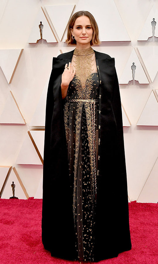 <a href=/tags/0/natalie-portman><strong>Natalie Portman</strong></a> had a regal moment at the Oscars in a black and gold <a href=/tags/0/dior-couture><strong>Dior Couture</a></strong>dress with a flowing cape. <p>Photo: &copy; Amy Sussman/Getty Images