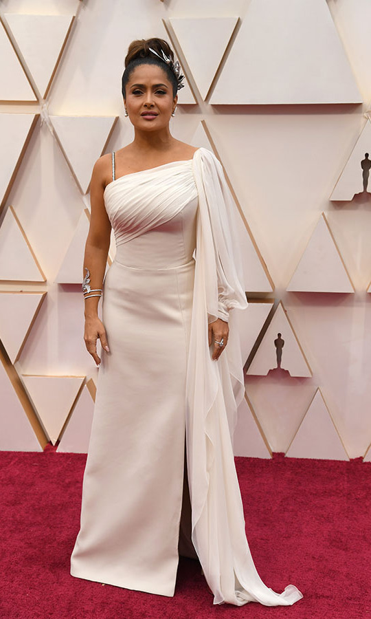Lovely in white! <a href=/tags/0/salma-hayek><strong>Salma Hayek</strong></a> looked sensational in a flowing white gown and ornate headpiece. <p>Photo: &copy; Jeff Kravitz/FilmMagic