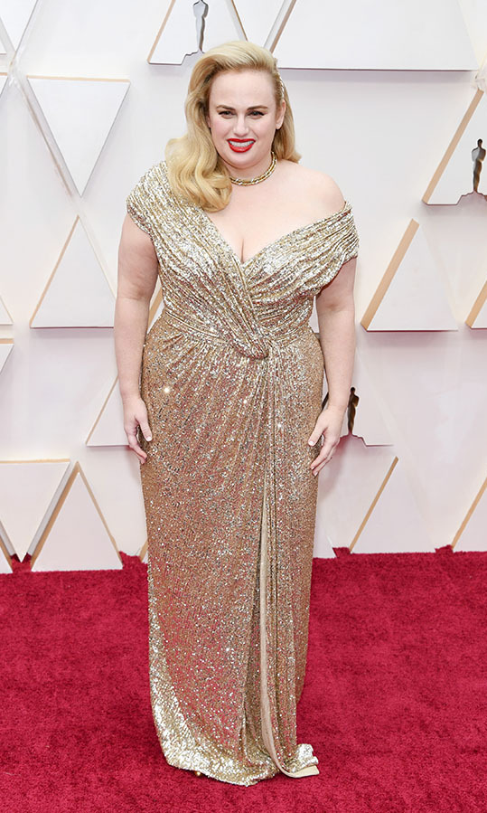 <em>Cats</em> actress <a href=/tags/0/rebel-wilson><strong>Rebel Wilson</strong></a> brought glamour in a glinting gold <Strong><a href=/tags/0/jason-wu>Jason Wu</a></strong> gown and Old Hollywood waves. She paired it with vintage Pomellato jewellery. <p>Photo: &copy; Kevin Mazur/Getty Images