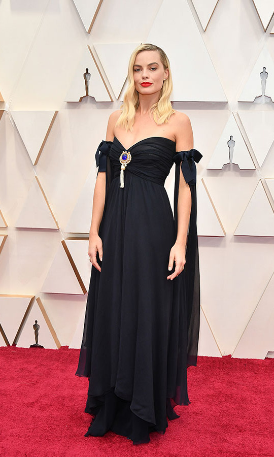 <a href=/tags/0/margot-robbie><strong>Margot Robbie</strong></a>, Best Supporting Actress nominee for <em>Bombshell</em>, captivated in a romantic <a href=/tags/0/chanel><strong>Chanel</strong></a> gown. <p> Photo: &copy; Amy Sussman/Getty Images