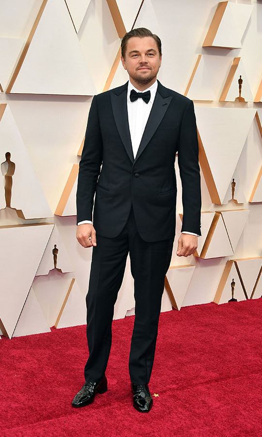 <a href=/tags/0/leonardo-dicaprio><strong>Leonardo DiCaprio</strong></a>, who is nominated for Best Actor, went with a classic vibe in a black <strong><a href=/tags/0/giorgio-armani>Giorgio Armani</a></strong> tuxedo with <strong><a href=/tags/0/david-yurman>David Yurman</a></strong> cufflinks and <strong><a href=/tags/0/christian-louboutin>Christian Louboutin</a></strong> shoes.<p>Photo: &copy; Amy Sussman/Getty Images