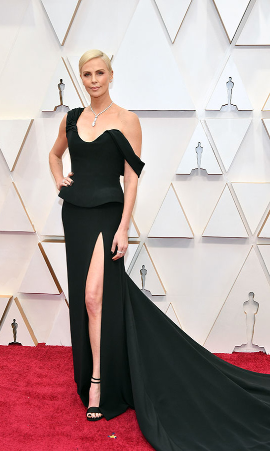 Beautiful! Best Actress nominee <a href=/tags/0/charlize-theron><strong>Charlize Theron</strong></a> looked sensational in a black <a href=/tags/0/dior><strong>Dior Couture</strong></a> gown paired with a statement <Strong><a href=/tags/0/tiffany>Tiffany</a></strong> necklace. <p>Photo: &copy; Amy Sussman/Getty Images