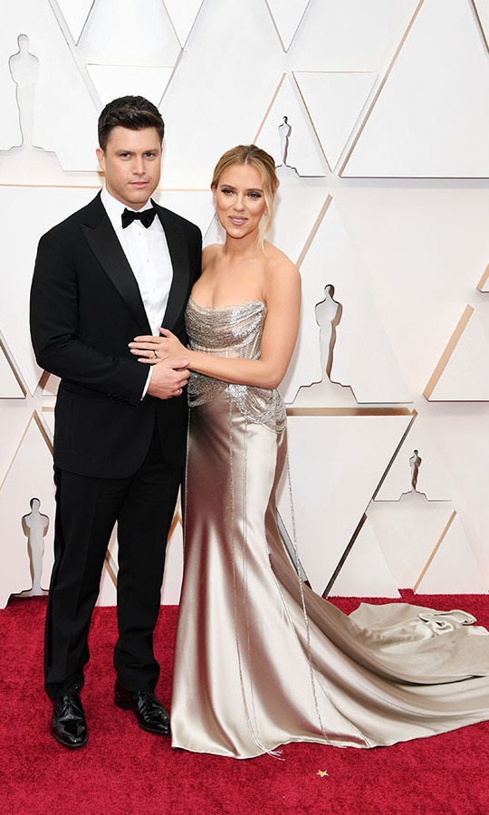 <a href=/tags/0/colin-jost><strong>Colin Jost</strong></a> and fiancée <a href=/tags/0/scarlett-johansson><strong>Scarlett Johansson</a></strong> looked so stylish (and cute!) at the 2020 Academy Awards. Scarlett wore a custom <strong><a href=/tags/0/oscar-de-la-renta>Oscar de la Renta</a></strong> gown with <strong>Forevermark</strong> jewellery, while her husband chose a <strong><a href=/tags/0/giorgio-armani>Giorgio Armani</strong></a> suit.  <p>Photo: &copy; Kevin Mazur/Getty Images