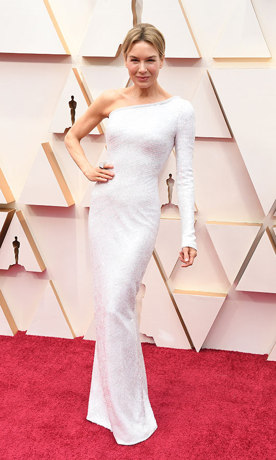 <a href=/tags/0/renee-zellweger><strong>Renée Zellweger</strong></a>, who is up for Best Actress for <em>Judy</em>, wowed in a one-sleeved white gown by <a href=/tags/0/armani><strong>Armani Privé</strong></a>. She paired it with <strong><a href=/tags/0/david-webb>David Webb</a></strong> jewellery and <Strong><a href=/tags/0/jimmy-choo>Jimmy Choo</a></strong> shoes. <p>Photo: &copy; Steve Granitz/WireImage