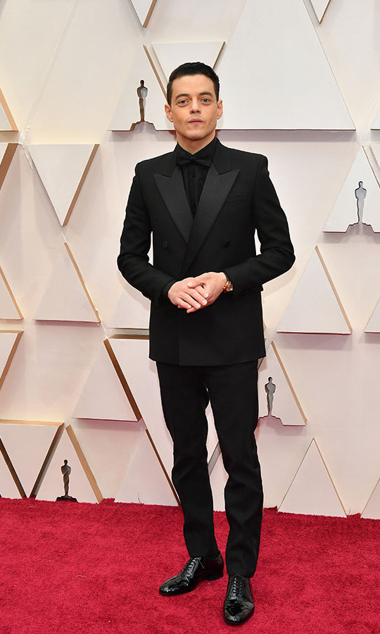 <a href=/tags/0/rami-malek><strong>Rami Malek</strong></a> was debonair in an all-black ensemble. <p>Photo: &copy; Amy Sussman/Getty Images