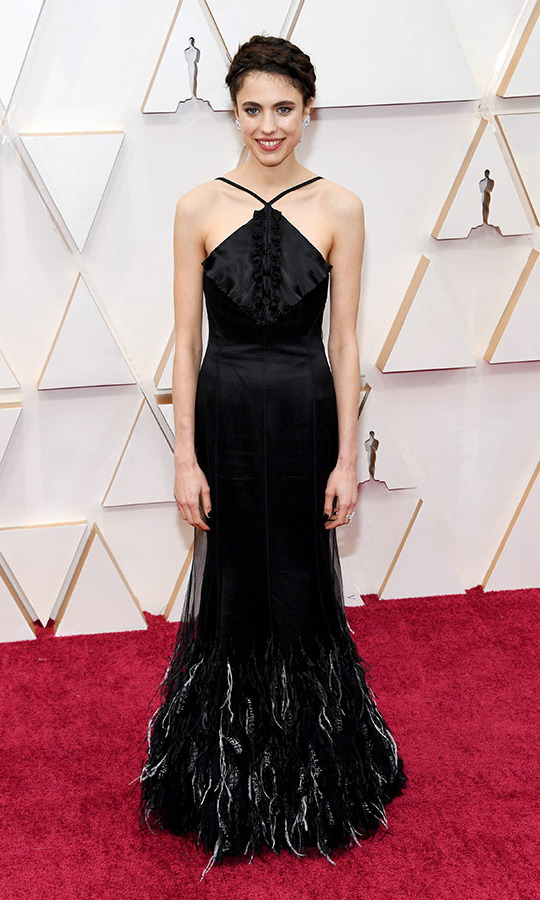 <em>Once Upon a Time... in Hollywood</em> actress <strong>Margaret Qualley</strong>'s elegant black <a href=/tags/0/chanel><strong>Chanel</strong></a> dress was trimmed in contrasting feathers. <p>Photo: &copy; Kevin Mazur/Getty Images