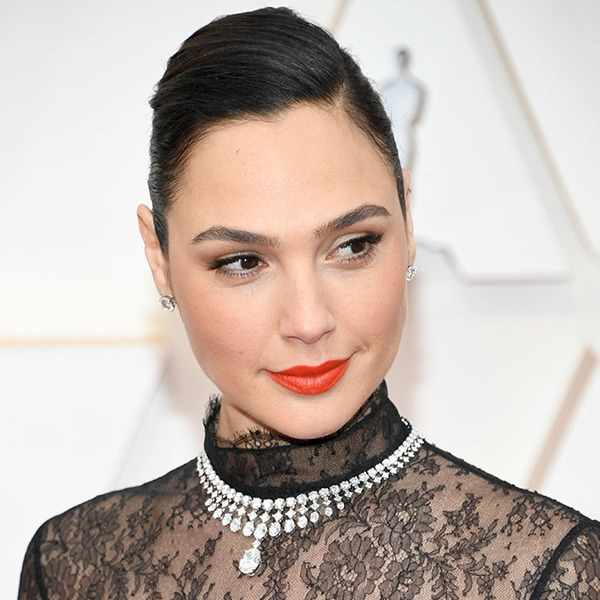 <em>Wonder Woman</em> actress <a href=/tags/0/gal-gadot><strong>Gal Gadot</strong></a> topped off her black lace bodice with a glittering necklace. <p>Photo: &copy; Kevin Mazur/Getty Images