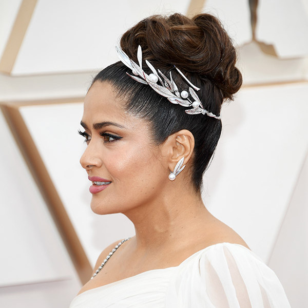 <a href=/tags/0/salma-hayek><strong>Salma Hayek</strong></a> topped off her Grecian-inspired gown with an ornate headband and coordinating earrings for even more wow factor. <p>Photo: &copy; Kevin Mazur/Getty Images