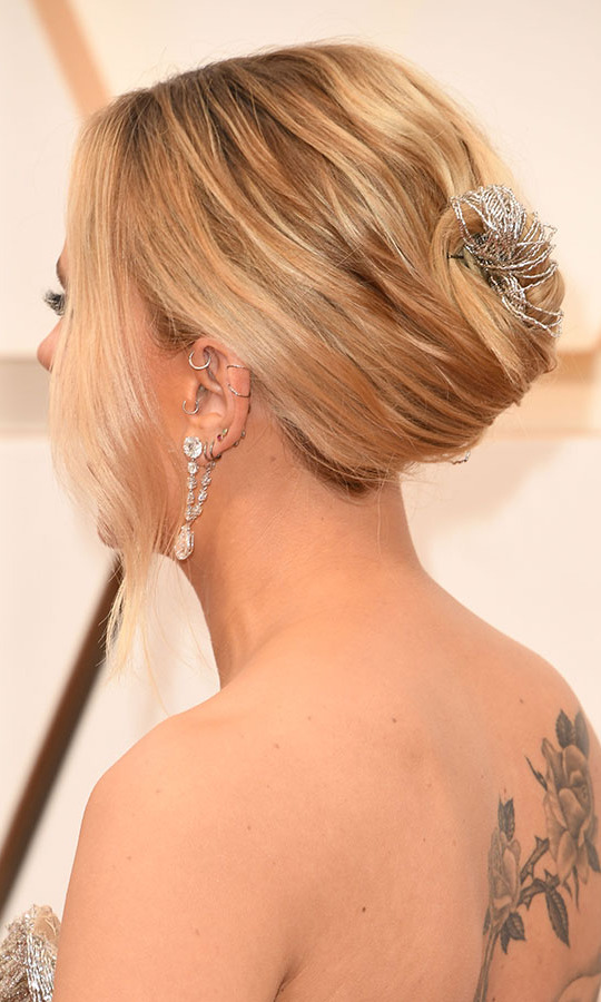 The actress's woven hair accessory also tied in the dress and her array of earrings. <p>Photo: &copy; ROBYN BECK/AFP via Getty Images
