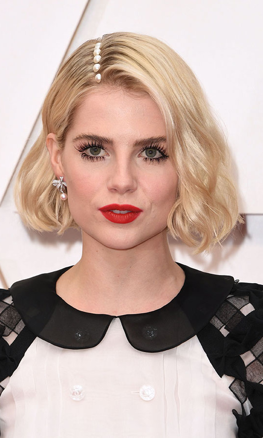 <em>Bohemian Rhapsody</em> actress <a href=/tags/0/lucy-boynton><strong>Lucy Boynton</strong></a> decorated her part with pearly accents that brought out the details on her dress! <p>Photo: &copy; Robyn Beck / AFP/ via Getty Images