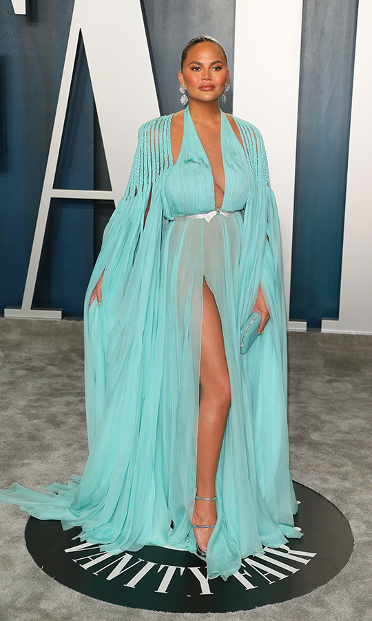 Fierce! Model <a href=/tags/0/chrissy-teigen><strong>Chrissy Teigen</strong></a> struck a pose in her flowing aqua gown. <p>Photo: &copy; JEAN-BAPTISTE LACROIX/AFP via Getty Images
