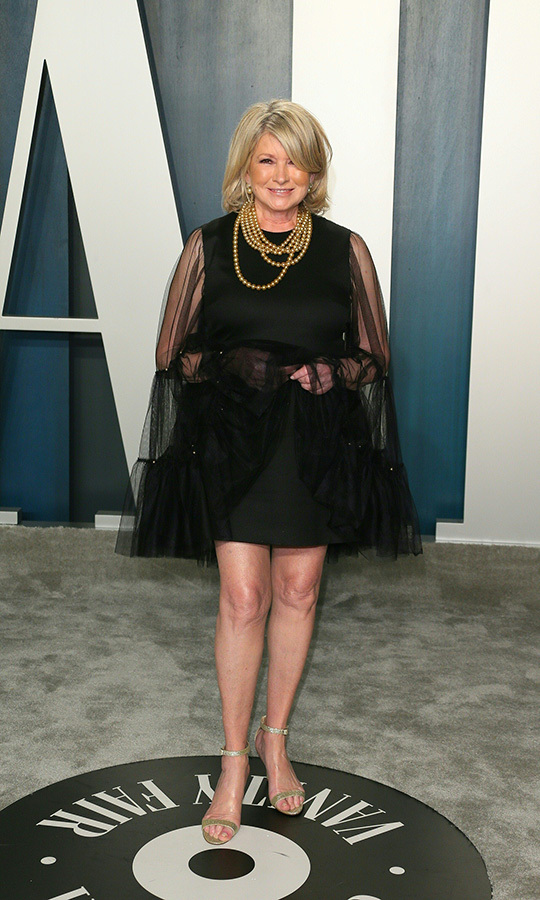<a href=/tags/0/martha-stewart><strong>Martha Stewart</strong></a> showcased her pins in a voluminous <a href=/tags/0/Giambattista-Valli><strong>Giambattista Valli</strong></a> black dress. <p>Photo: &copy; JEAN-BAPTISTE LACROIX/AFP via Getty Images