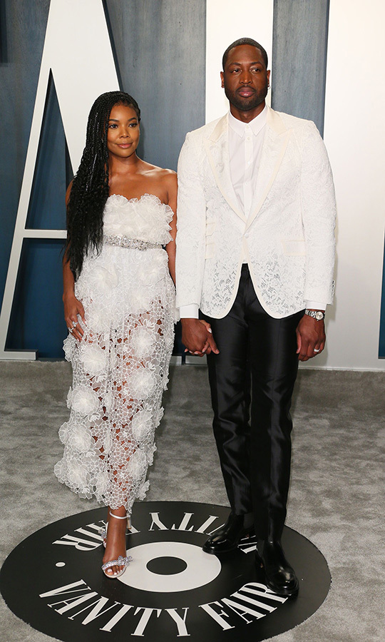 <a href=/tags/0/Gabrielle-Union><strong>Gabrielle Union</strong></a> and <a href=/tags/0/Dwyane-Wade><strong>Dwyane-Wade</strong></a> were perfectly coordinated in white lace at the 2020 Vanity Fair Oscar party. <p>Photo: &copy; JEAN-BAPTISTE LACROIX/AFP via Getty Images