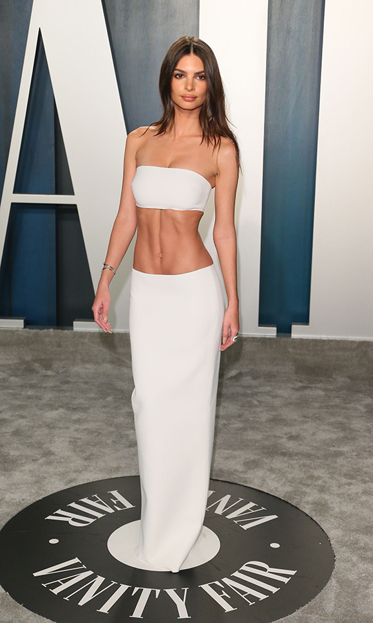 Model and fashion designer <a href=/tags/0/Emily-Ratajkowski><strong>Emily Ratajkowski</strong></a>  showcased her rock-hard abs in a trendy bandeau top and matching maxi skirt. <p>Photo: &copy; JEAN-BAPTISTE LACROIX/AFP via Getty Images