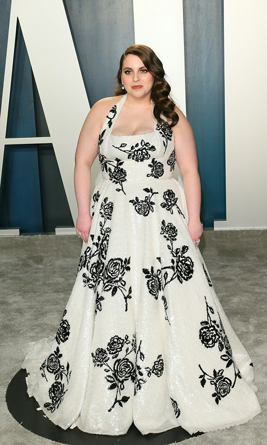 <strong><A href=/tags/0/beanie-feldstein>Beanie Feldstein</a></strong> looked classically beautiful in a white-and-black dress with rose detailing.