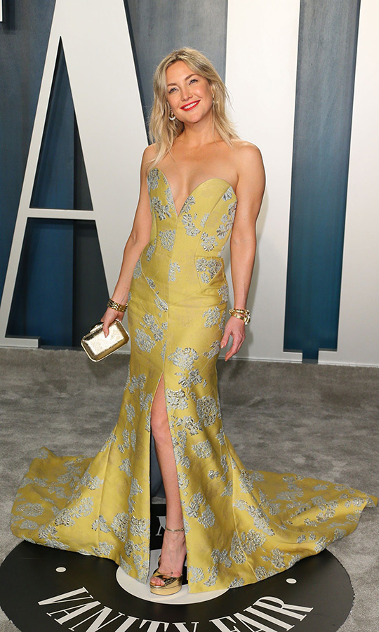 <strong><a href=/tags/0/kate-hudson>Kate Hudson</a></strong> showed off her playful side in a mustard dress with gorgeous grey floral detailing.